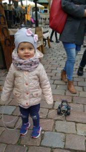 child on market square